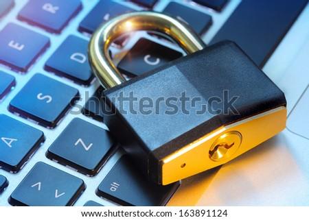 Padlock on computer keyboard - stock photo