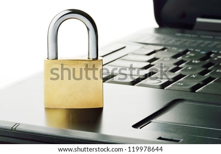 Padlock on notebook keyboard, symbolizing computer related security - stock photo