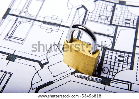 padlock on plans document in white