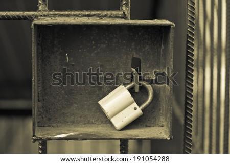 padlock on the iron door  - stock photo