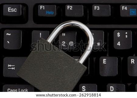 padlock on the keyboard - stock photo