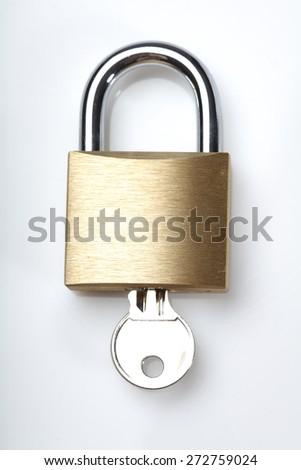 Padlock on white background - close-up - stock photo