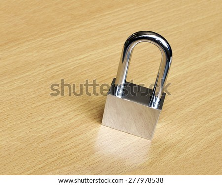 Padlock on Wooden Background.