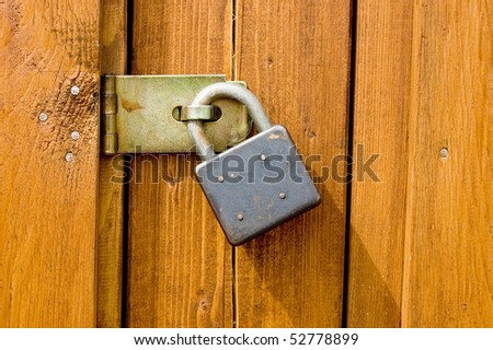 Padlock on wooden background