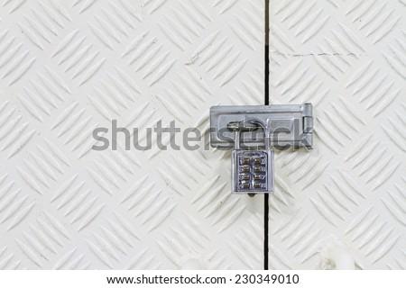 Padlock with combination code on aluminium background - stock photo