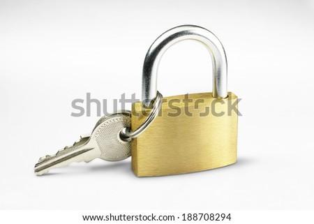 Padlock with key (clipping path) - stock photo