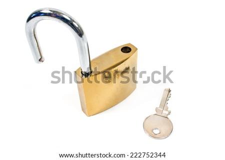 Padlock with key isolated on white - stock photo