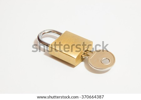 Padlock with key on a white background