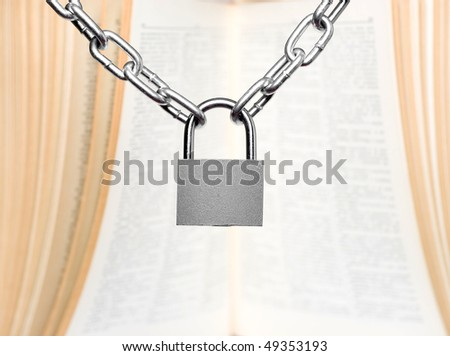 padlock with old book on background