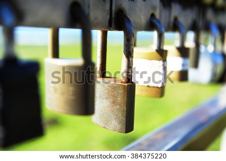 padlocks chained on a gate - stock photo