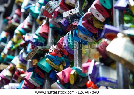Padlocks hanging on gate in Juliet's courtyard in Verona - stock photo