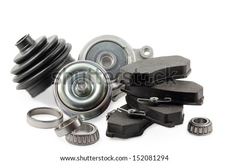 pads and spare parts for the car on a white background - stock photo