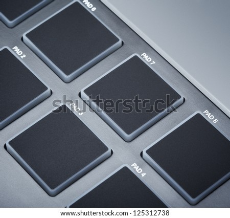 pads on digital midi keyboard, close up - stock photo