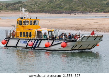 Padstow,UK - May 28th 2015:Passenger ferry crossing from Padstow to Rock across the Camel Estuary is heavily used by tourists visiting Padstow.