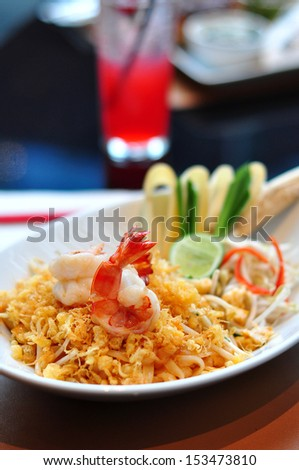 Padthai  with prawn or (fried rice noodle with prawn )on a white plate, a famous Thai food. - stock photo