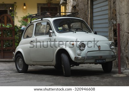 PADUA, ITALY - APRIL 17 2014 - An old white Fiat 500 parked in a street of the City of Padua, Italy - stock photo