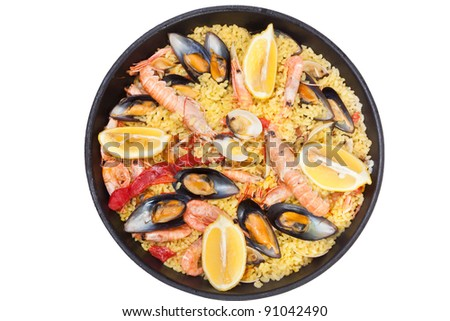Paella, Spanish dish with mussels and different types of seafood - stock photo