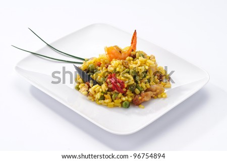 Paella, typical Spanish dish on white background - stock photo