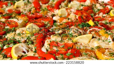 paella valenciana with seafood and mixed vegetables - stock photo