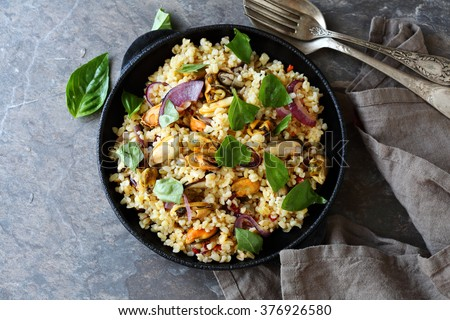 paella with bulgur, food top view - stock photo