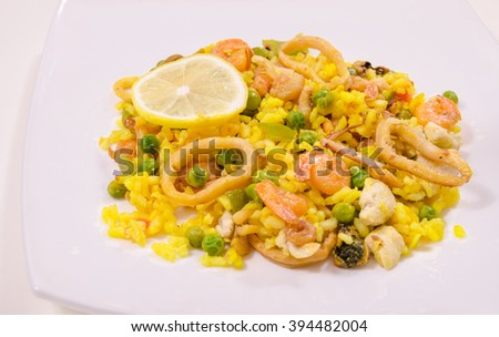 Paella with chicken and seafood, white background,close-up - stock photo