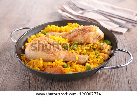 paella with chicken leg and seafood - stock photo
