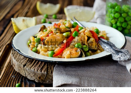 Paella with mussels and green peas - stock photo