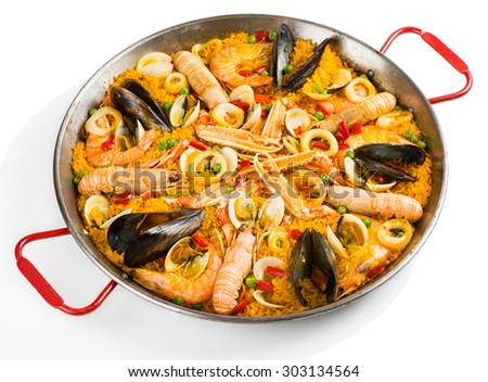 Paella with seafood in a paellera isolated on white background - stock photo