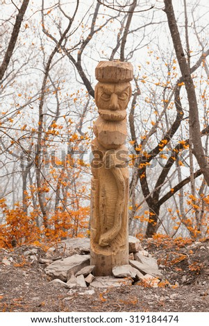 Pagan idols in autumn forest - stock photo