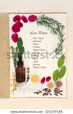 Pagan love potion ingredients over natural hemp notebook and mottled cream paper background. With ingredient list. - stock photo