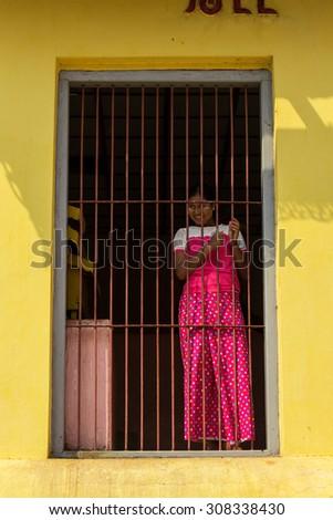 PAGAN, MYANMAR- MARCH 10, 2015: The local Burmese lady at Shwesigon Pagoda. - stock photo