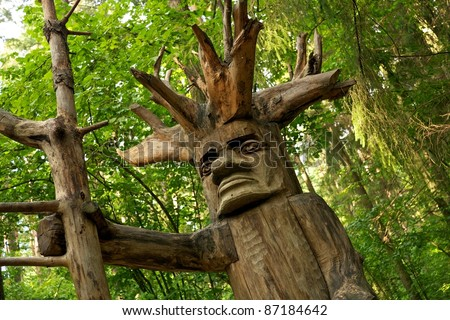 Pagan wooden idol in a woods.