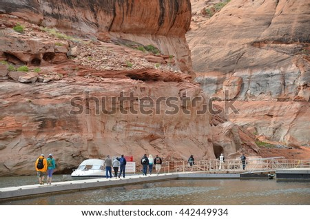 PAGE, AZ - MAY 24: Rainbow Bridge Cruise at Lake Powell on May 24, 2015 in Page AZ,USA. Thousands of people from all over the world come to visit this beautiful place every year. - stock photo
