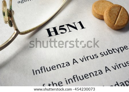 Page of book with diagnosis h5n1 and glasses.