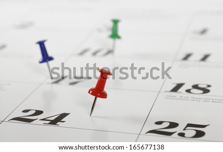 Page of calendar with push pin. - stock photo