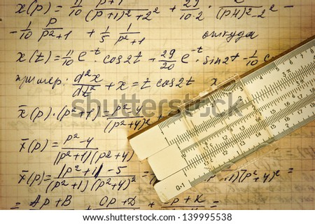 Page of old vintage paper with the calculation of the mathematics and slide rule - stock photo