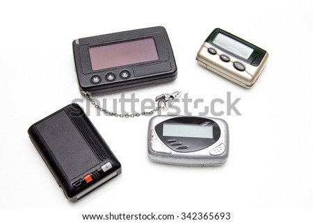 Pagers on white background.