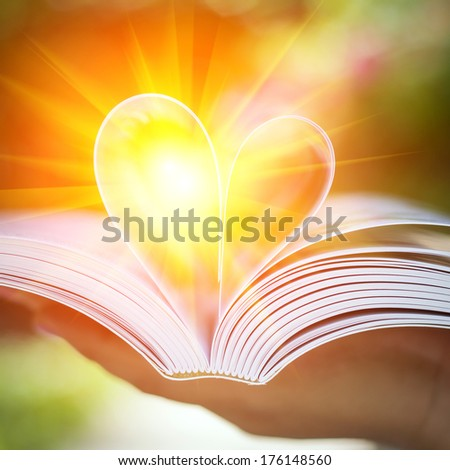 Pages of a book curved into a heart shape.  - stock photo