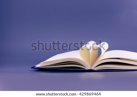 Pages of a book curved into a heart shape style for background