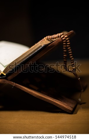 pages of holy koran and rosary at the book - stock photo