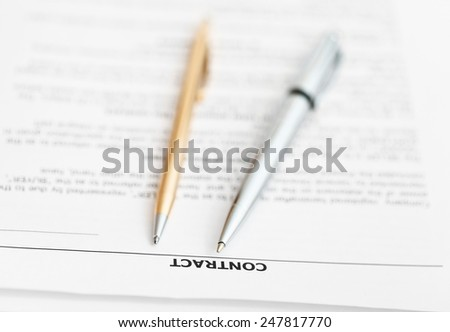 pages of sales contract and two pens close up - stock photo