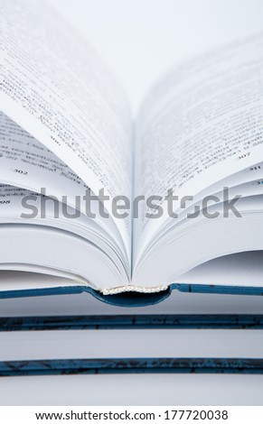 Pages of the book macro on white background