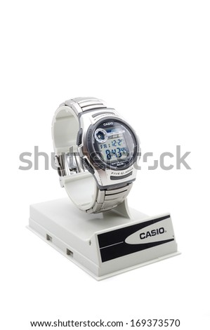 PAHANG, MALAYSIA-Dec 27, 2013: Photo of a modern Casio watch on casing, isolated on white