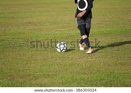 Pahang, Malaysia - 05 mac 2016 : Little Boy training how to dribbling a soccer on the sports field for sport development from national sport council projects in school