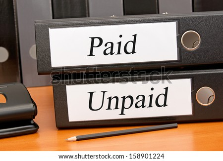 Paid and Unpaid - stock photo