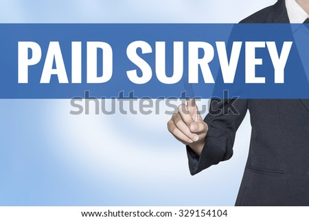Paid Survey word on virtual screen touch by business woman blue background - stock photo