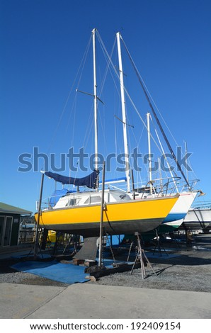 PAIHIA,NZ - MAY 11 2014:Sail yachts beached at a dock for painting ,repair and maintenance in Opua Marina. It's a 250-berth Marina,popular destination for cruising yachts to NZ from all over the world - stock photo