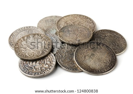Pail of  thalers - ancient european silver coins isolated on white - stock photo