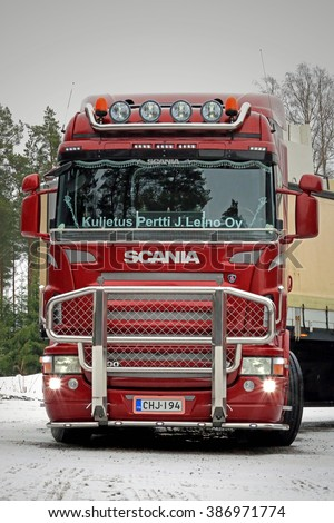 PAIMIO, FINLAND - FEBRUARY 20, 2016: Red Scania R500 truck with bull bar in South of Finland.  In 2015, Scania is Finnish the market leader in heavy trucks. - stock photo