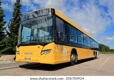 PAIMIO, FINLAND - JULY 19, 2014: Yellow Scania Citywide bus waits for passengers. Scania Citywide is available in low-floor and low-entry versions. - stock photo